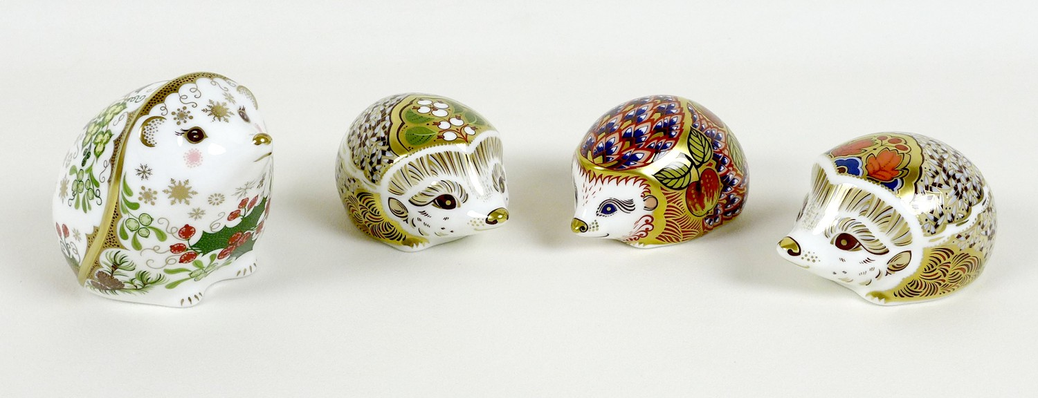 A group of four Royal Crown Derby paperweights, all modelled as hedgehogs, comprising 'Orchard
