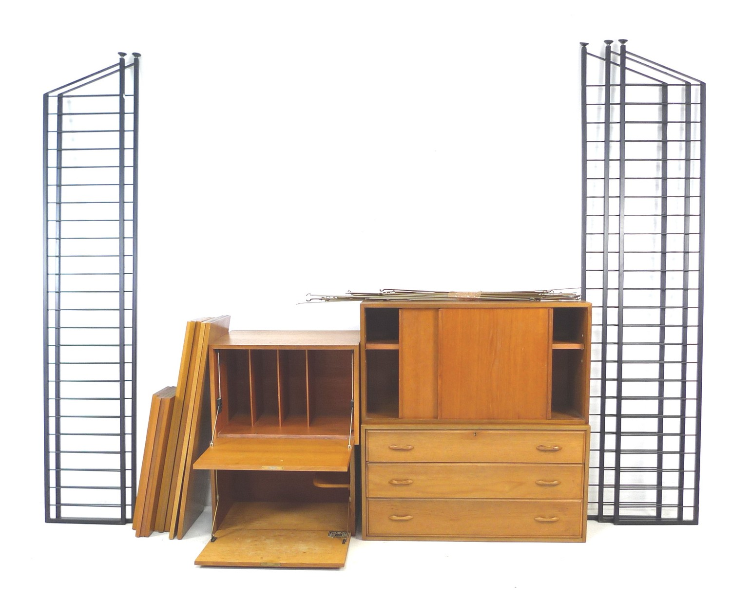 A set of Ladderax, Staples, adjustable shelving units, with four storage, desk and drawer units,