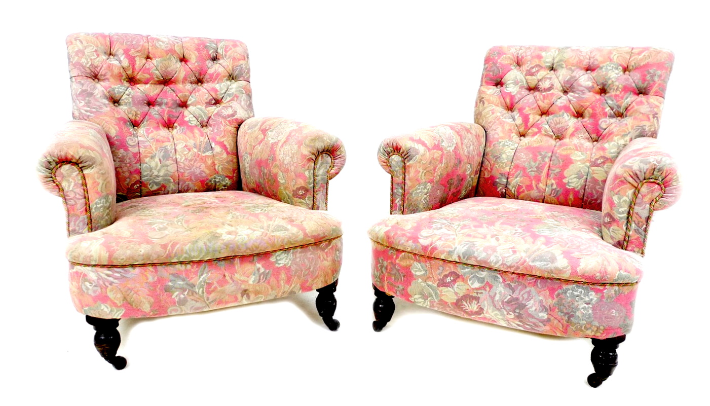 A pair of Victorian easy armchairs, in the style of Howard & Sons, upholstered in pink and grey