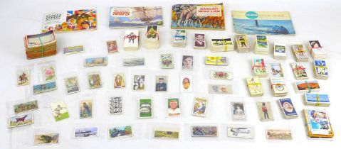 A large collection of cigarette cards and matchboxes and other ephemera,