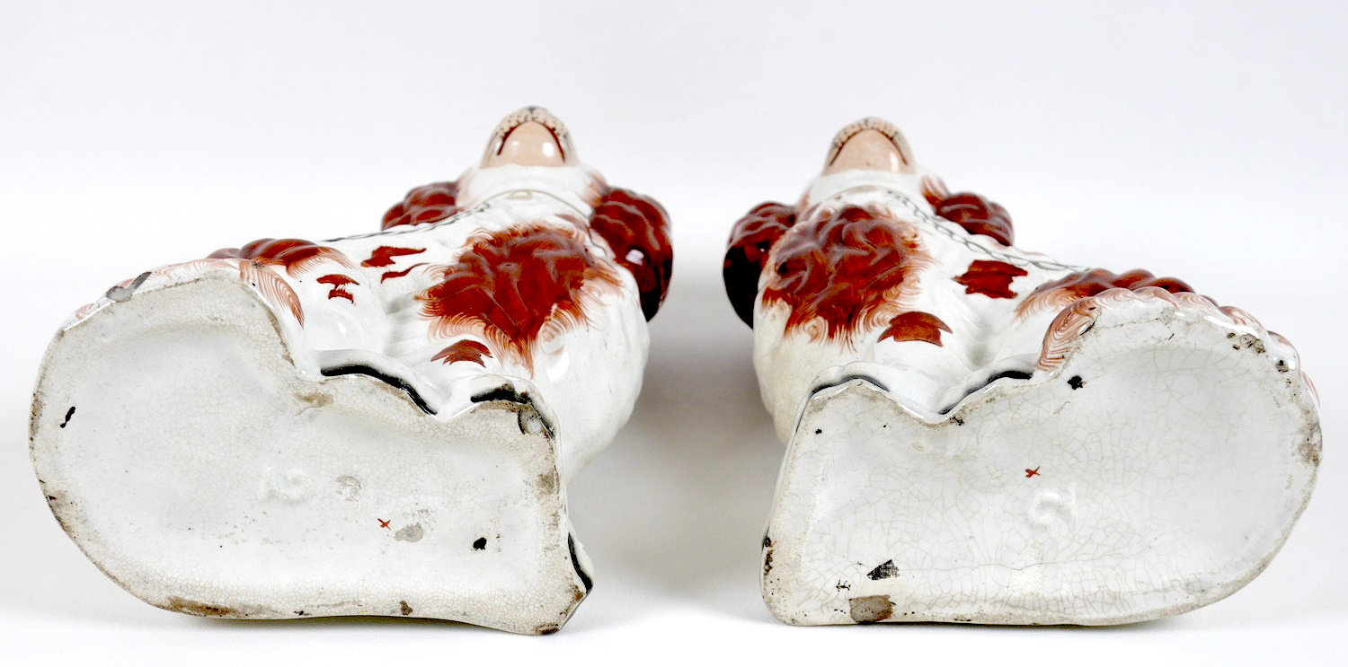 A pair of Victorian Staffordshire flatback fireside dogs, modelled as spaniels, each 25cm high. (2) - Image 4 of 4