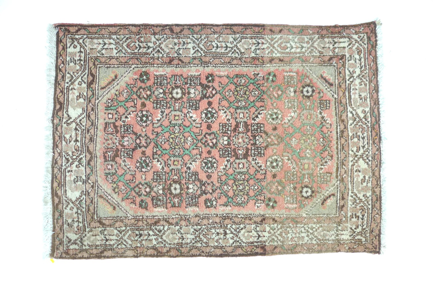 A small Persian prayer rug, with pale red ground, 120 by 85cm.