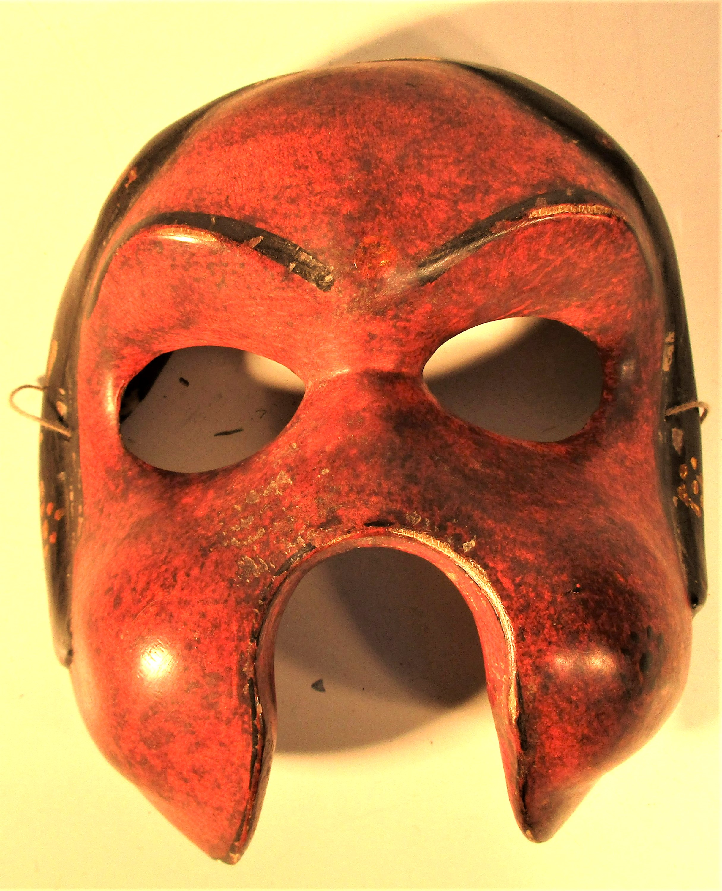 Balinese Topeng 1/2 mask painted red. 15 x 15cm. Mid 20th c.