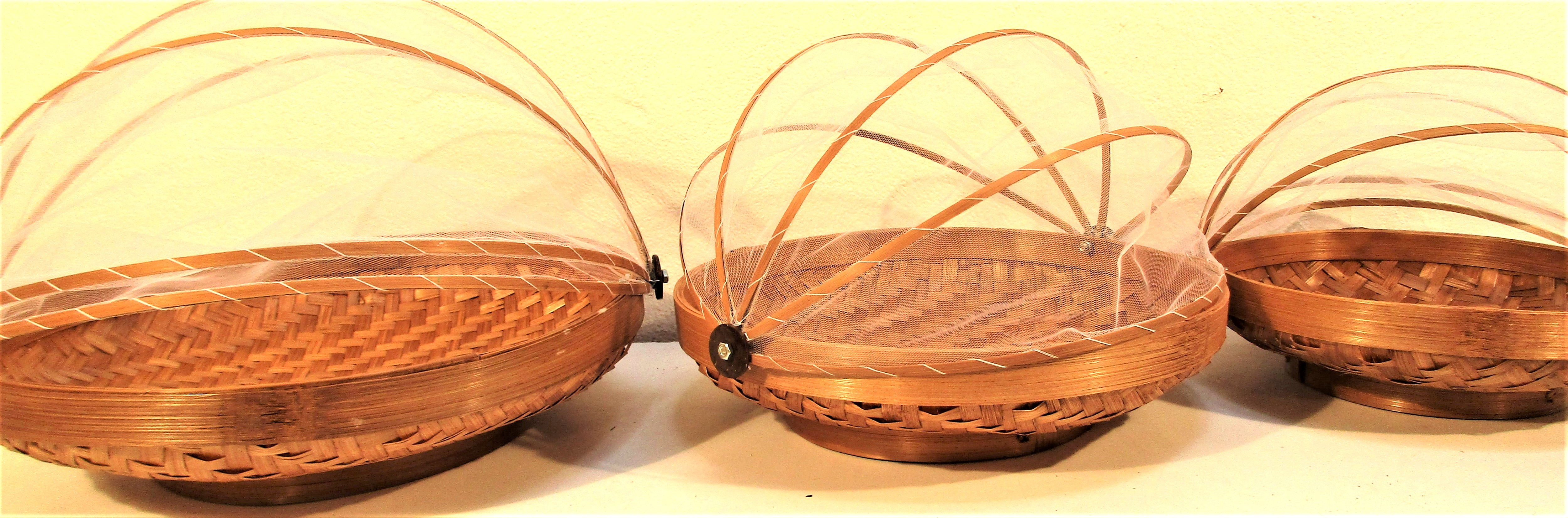 Set 3 fruit baskets, rattan with net cover. These are used in every household in Java. 38 + 30 +