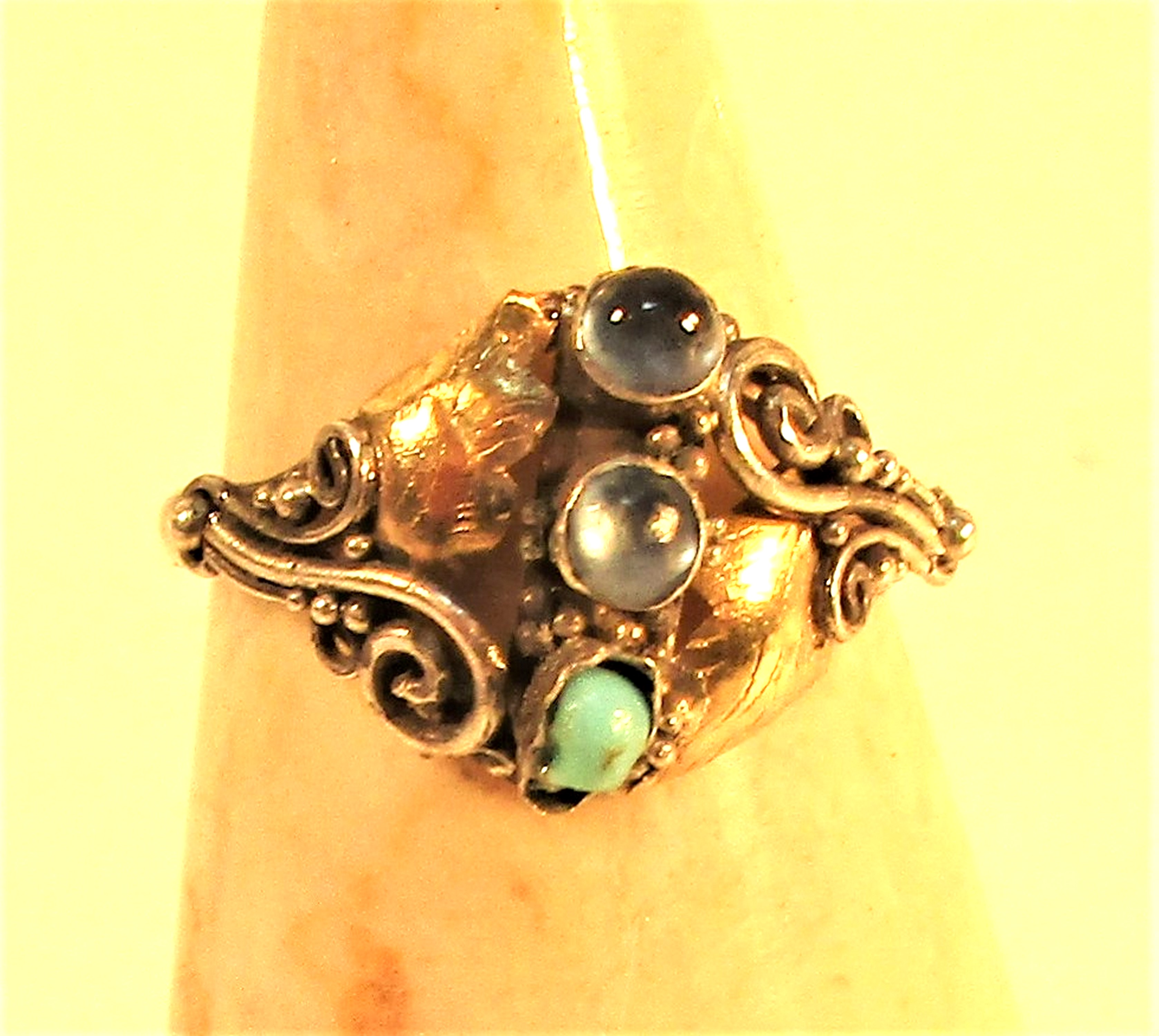 925 silver ring with gold wash and 3 semi precious stones.