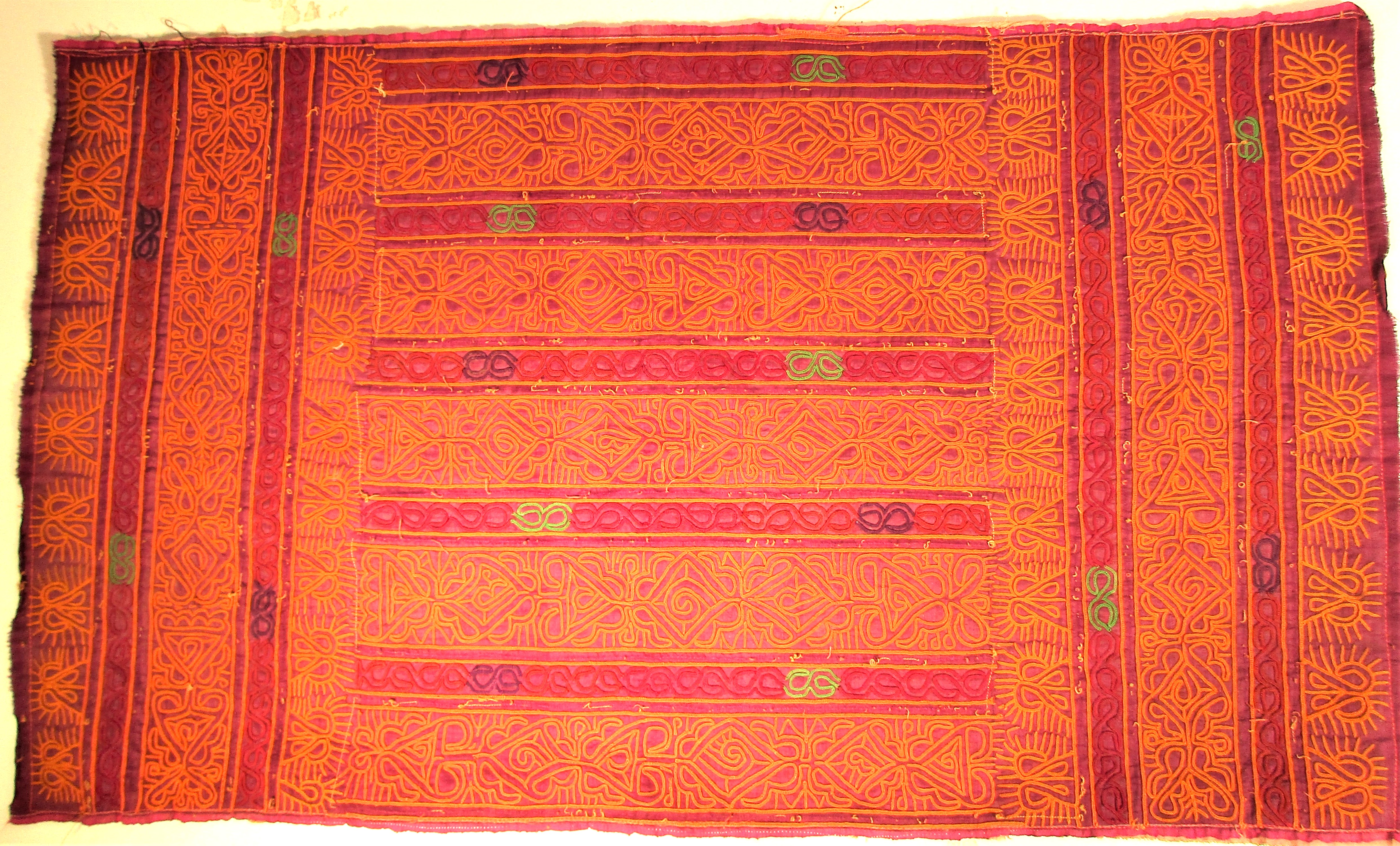 Hazara bread cover. Silk with chain stich decoration. . 76 x 45cm. Late 20th c. Notes: Textiles of