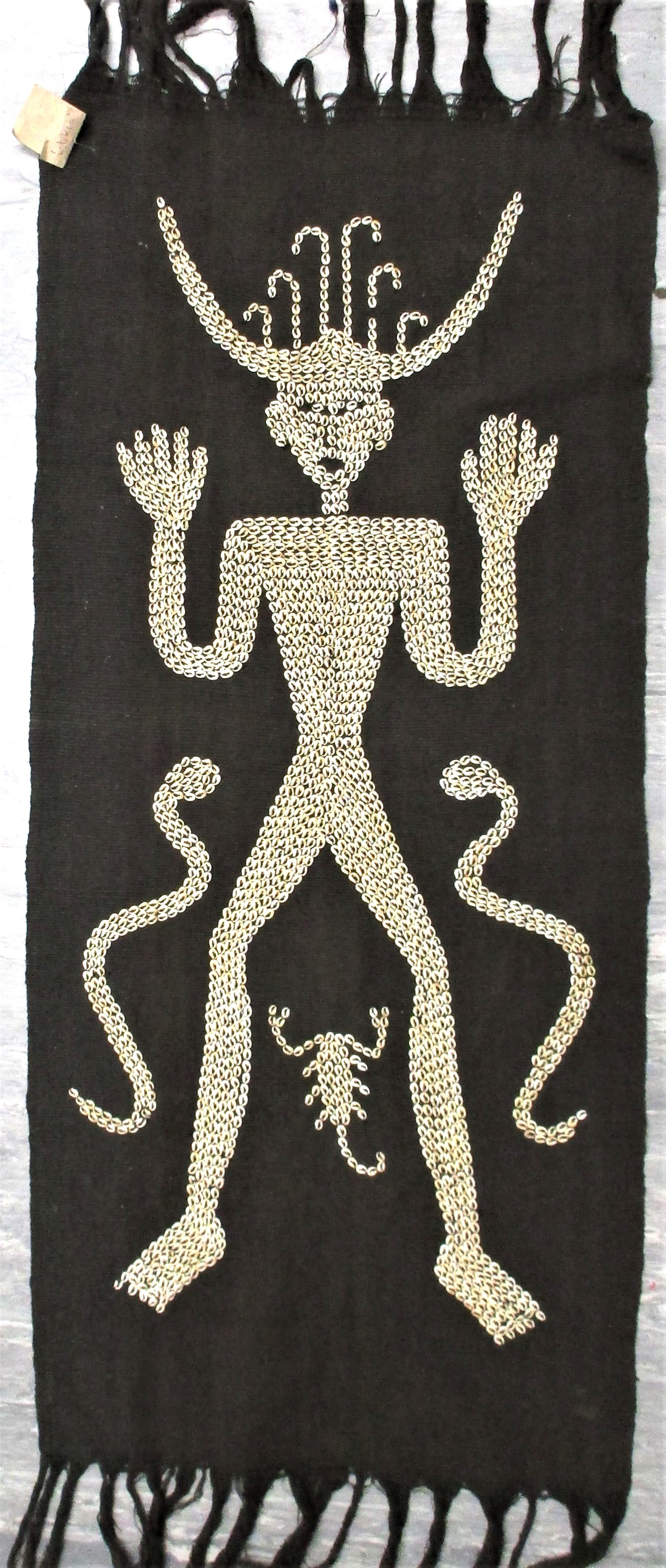 A ceremonial hanging, lau hada, from east Sumba . Raw cotton dyed with black indigo and