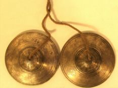 Tibetan Tingsha cymbals. Traditional for use in meditation, they have a good sound. Engraved with a