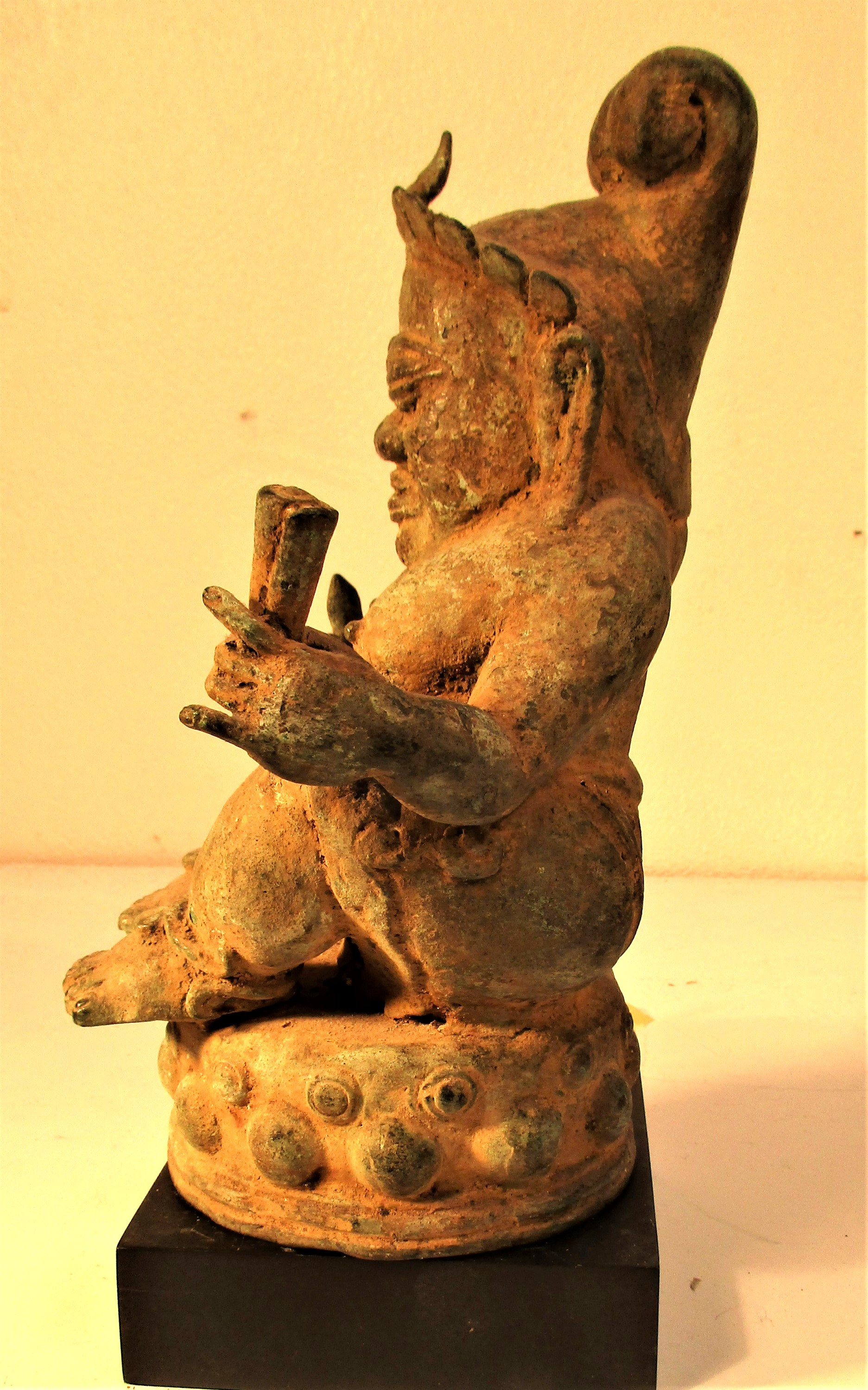 Bronze Chinese Buddha, cast in Bali. Buddha is holding a torje and a horn. 25 x 15cm. Early 21st c. - Image 2 of 4