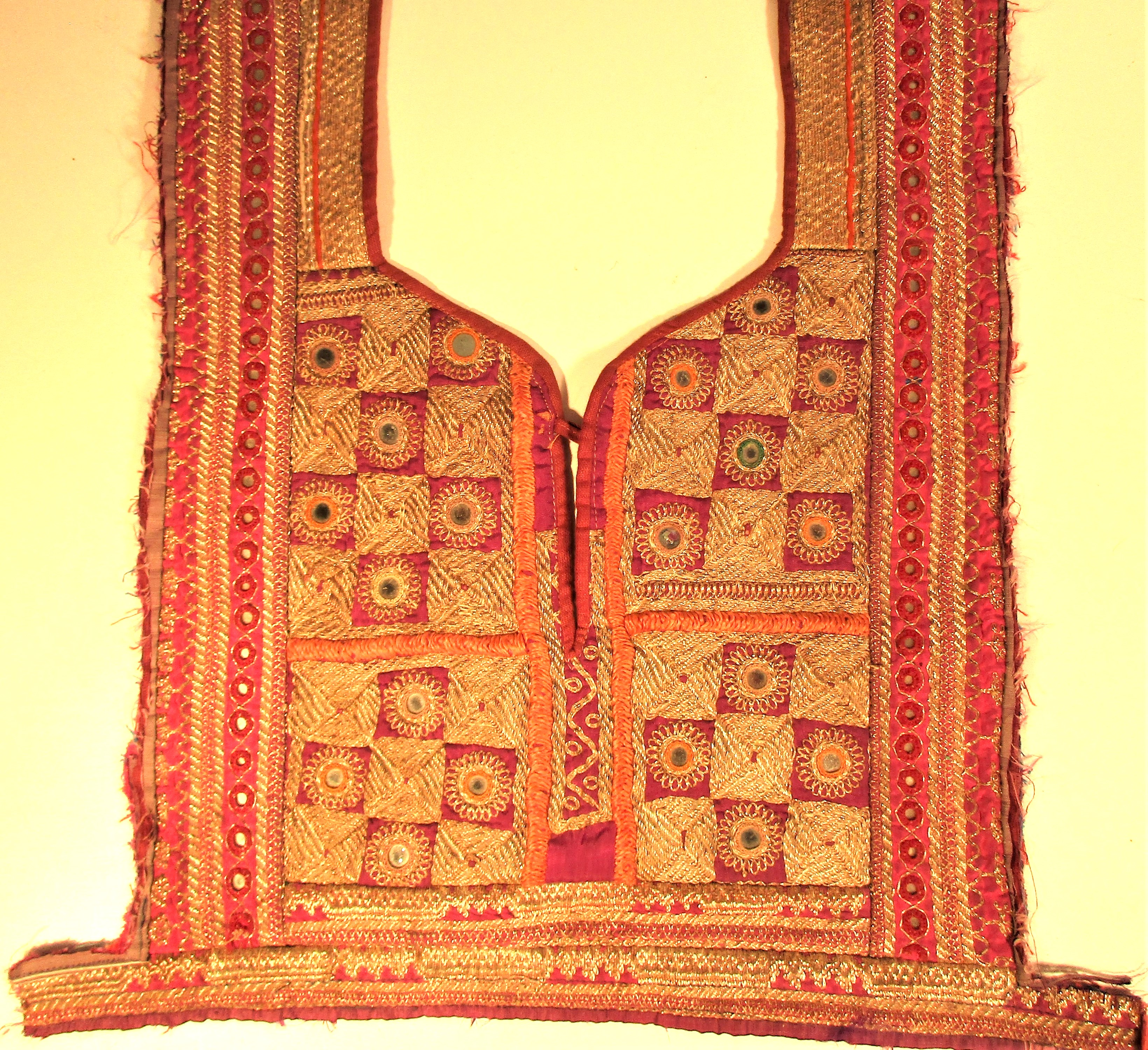 Hazara dress front. Women and children of most tribes in central Asia wear a long dress with an