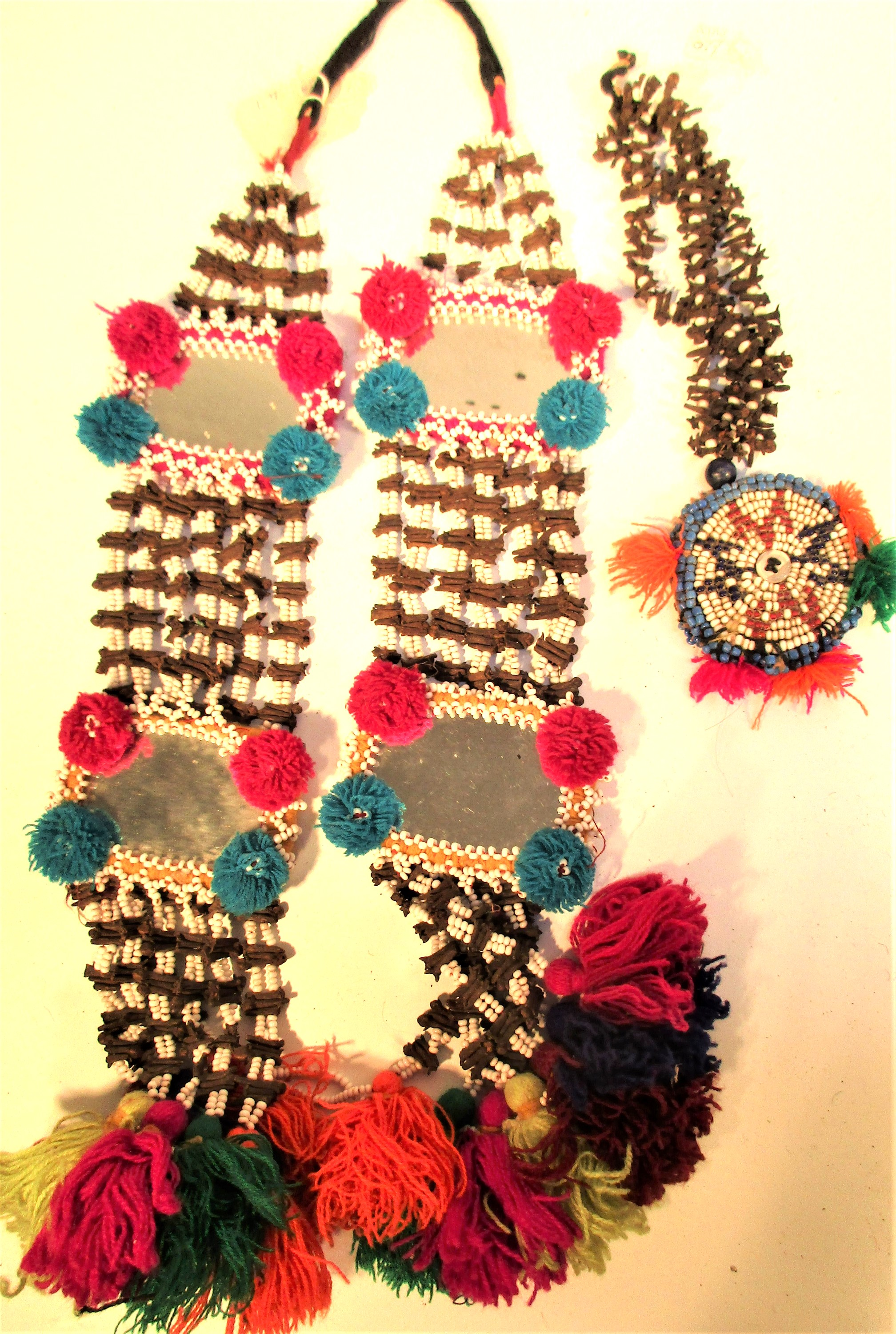 Afghanistan. Mirror, cloves and gul-i-peron. This would be hung amongst cloths, textiles and