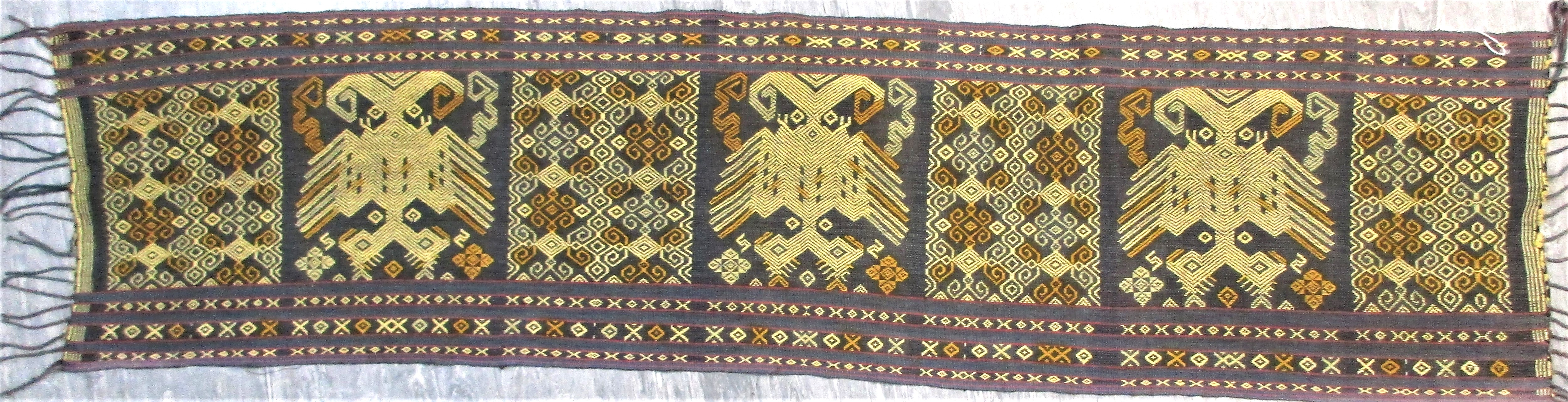 Ceremonial sash from east Sumba with a pattern of mythical birds and geometric patterns worked in