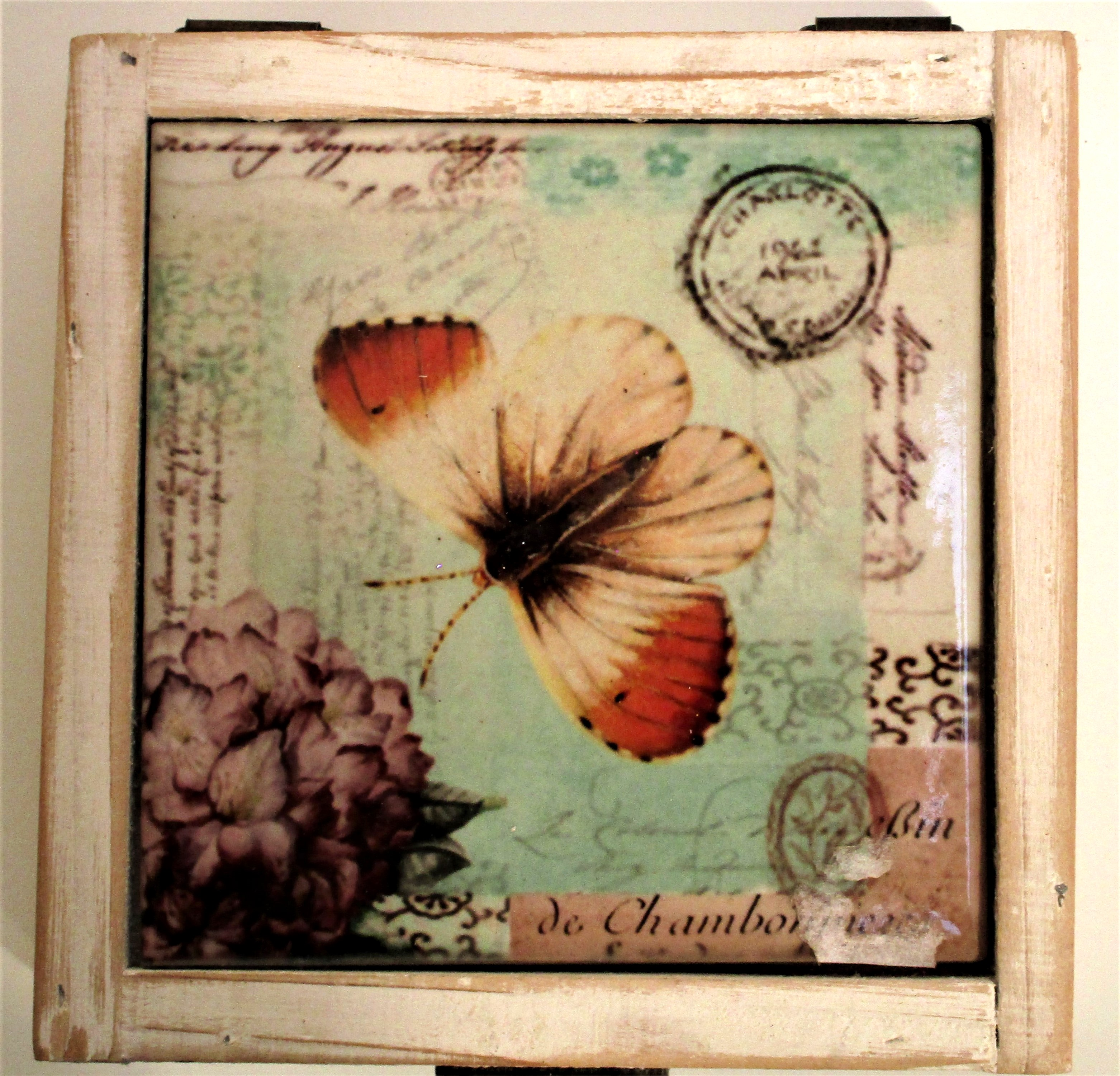 Storage box with orange tip butterfly and postage mark designed tile on the lid. Painted white
