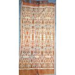 Toraja wrap from Sulawesi. Warp-Ikat weave in hand spun raw cotton. It is woven in two halves on a
