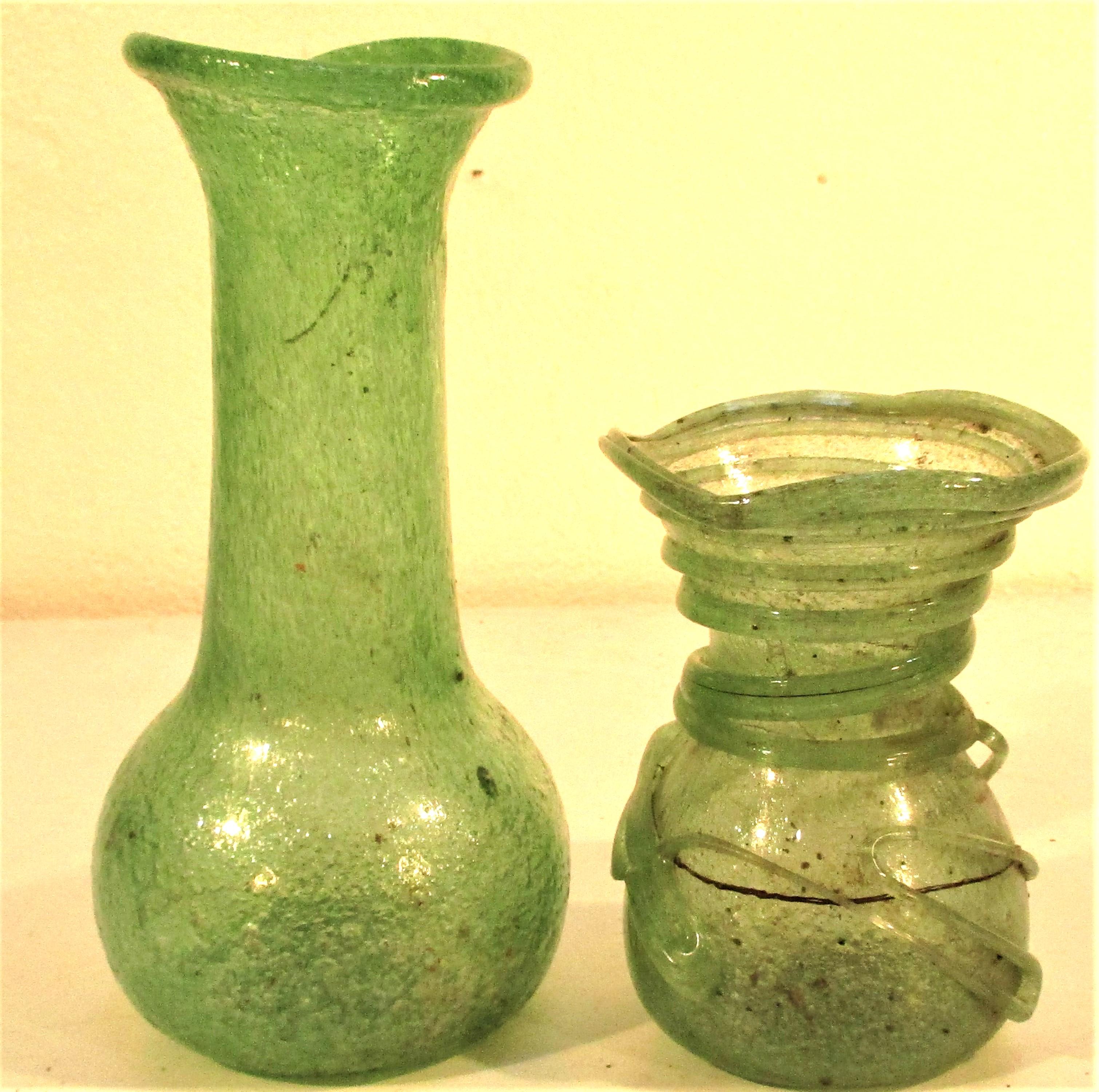 2x Afghan glass vases. Each 20 x 9cm.