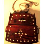 Tobacco pouch possibly from Lombok or Java. . Made from a hardwood with fragments of shell. 12 x