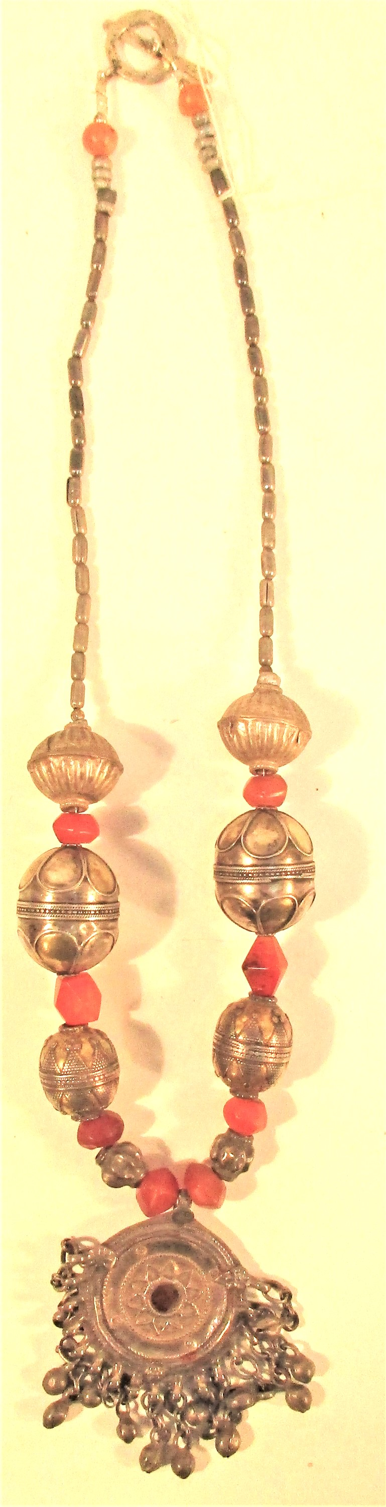 Afghan necklace with antique pendant and cornelian and metal beads. 30cm.