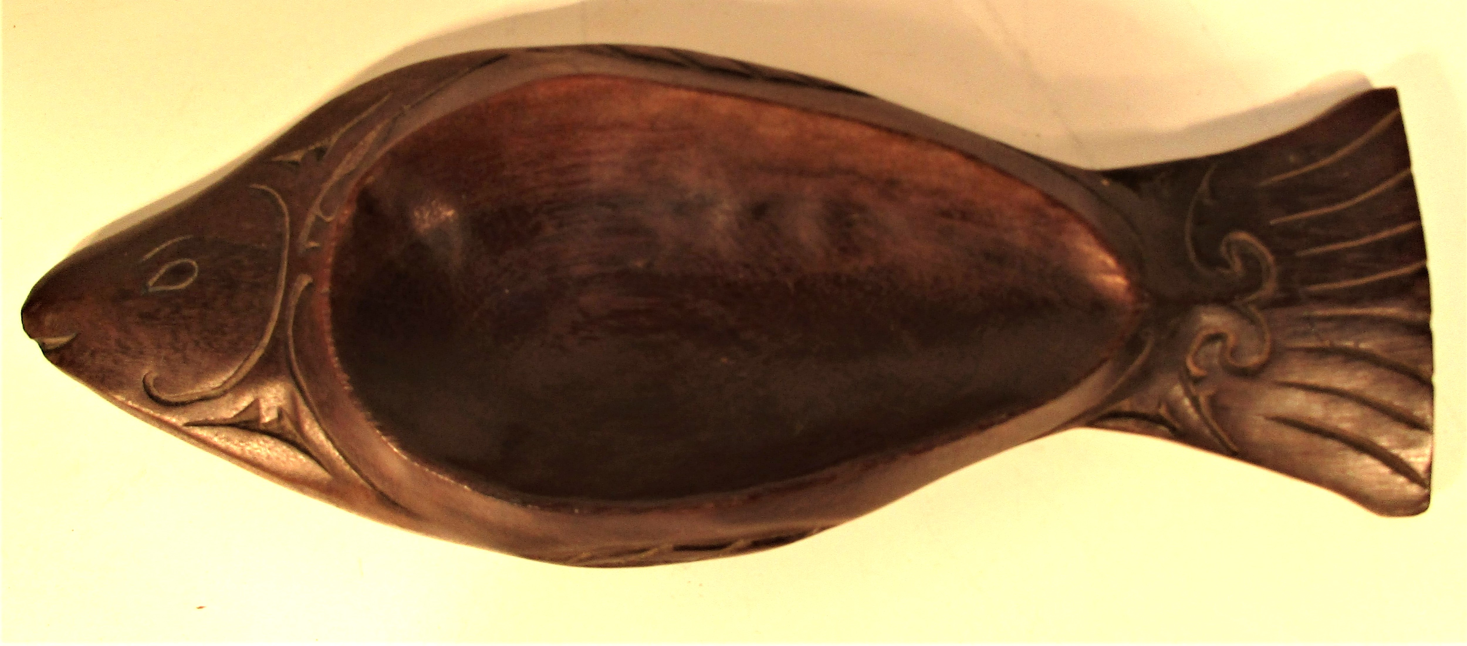 A small dish carved coconut wood in the form of a fish. Indonesia. 29 x 11cm. New.