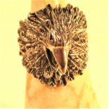 Cast white metal ring in form of an eagle.