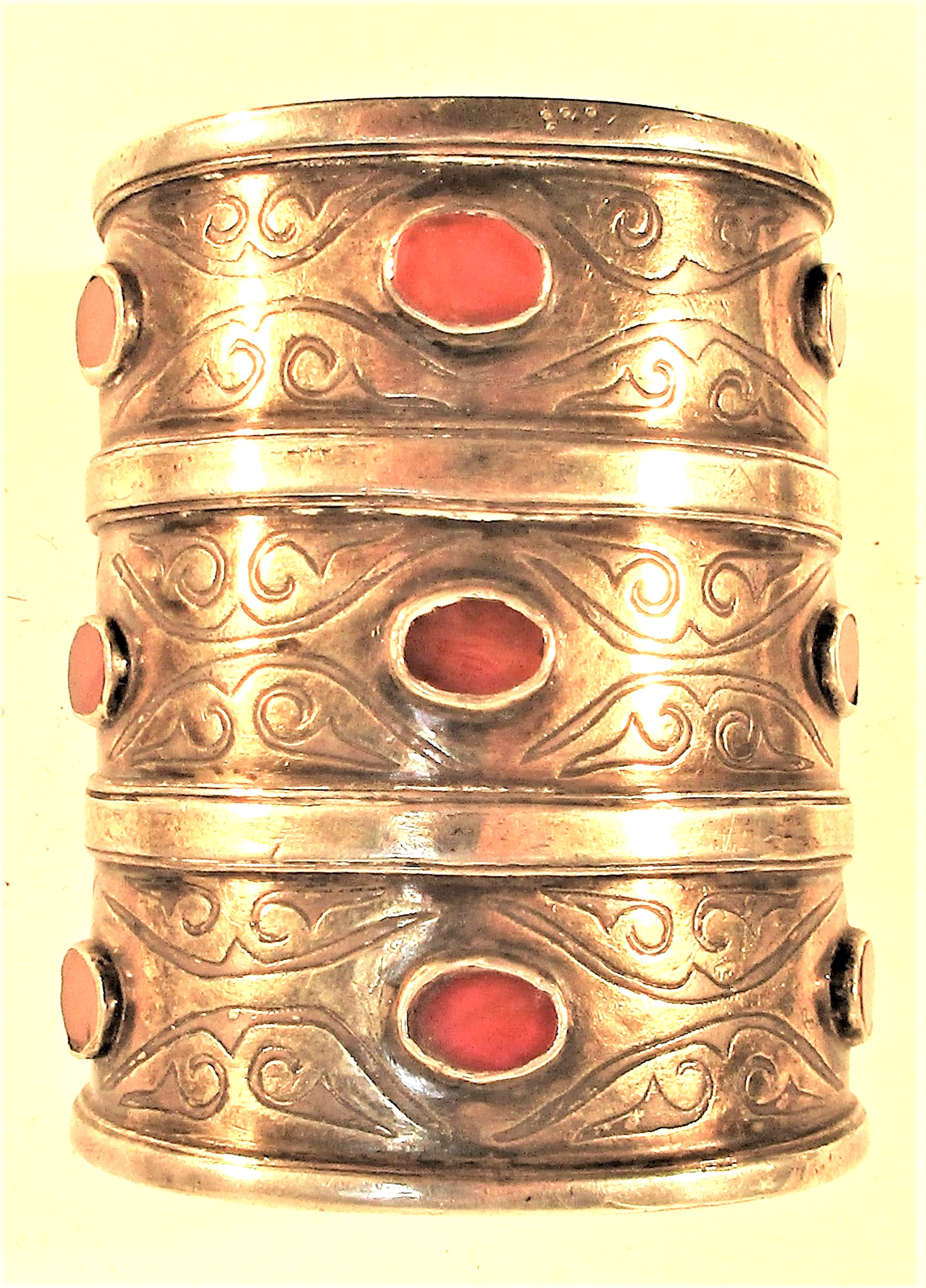 A very traditional antique Turkoman bracelet. White metal with gold wash and 9 cornelians. This is a