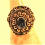 Metal with gold wash and glass stone ring with a secret compartment.