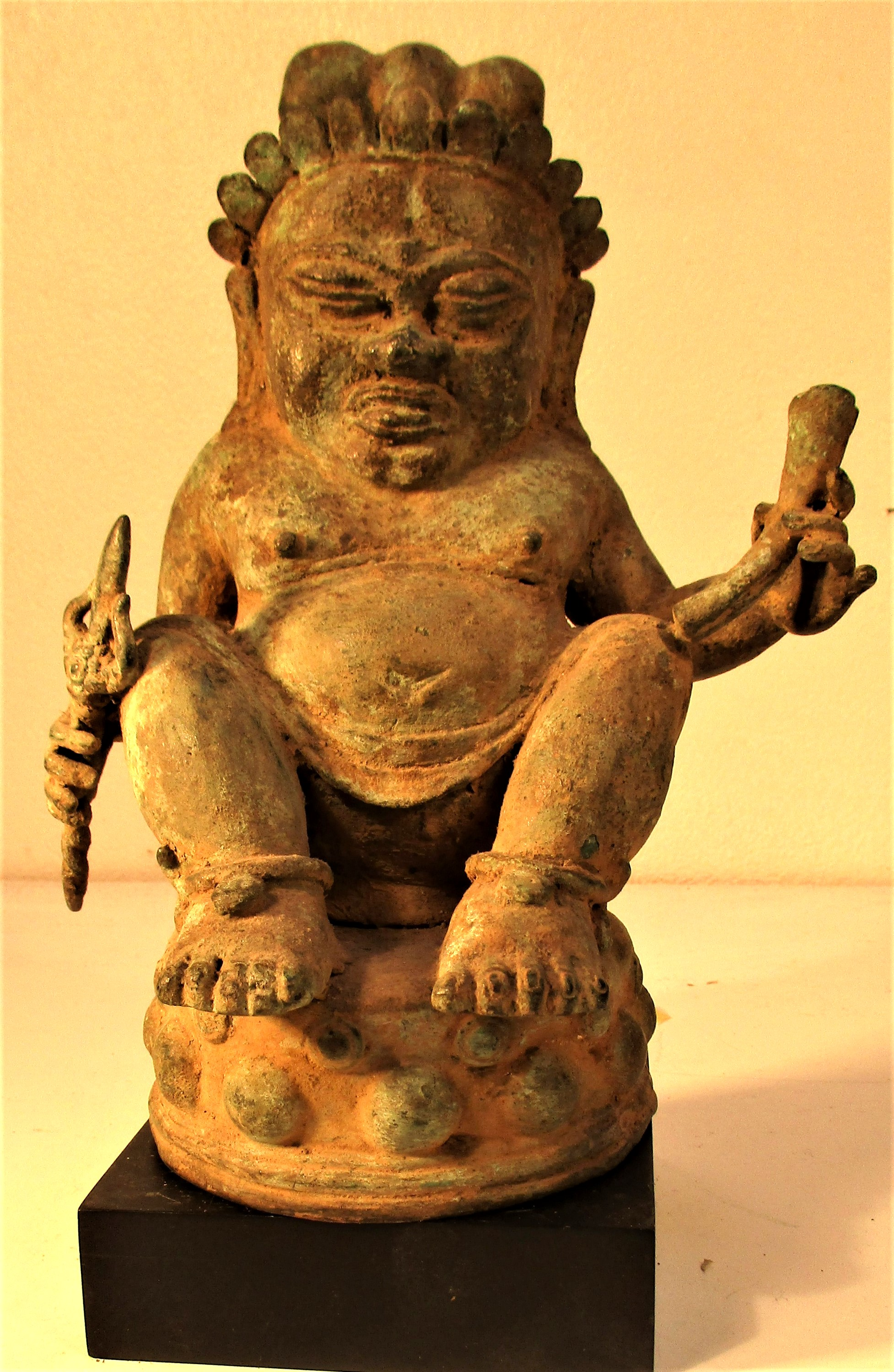 Bronze Chinese Buddha, cast in Bali. Buddha is holding a torje and a horn. 25 x 15cm. Early 21st c.
