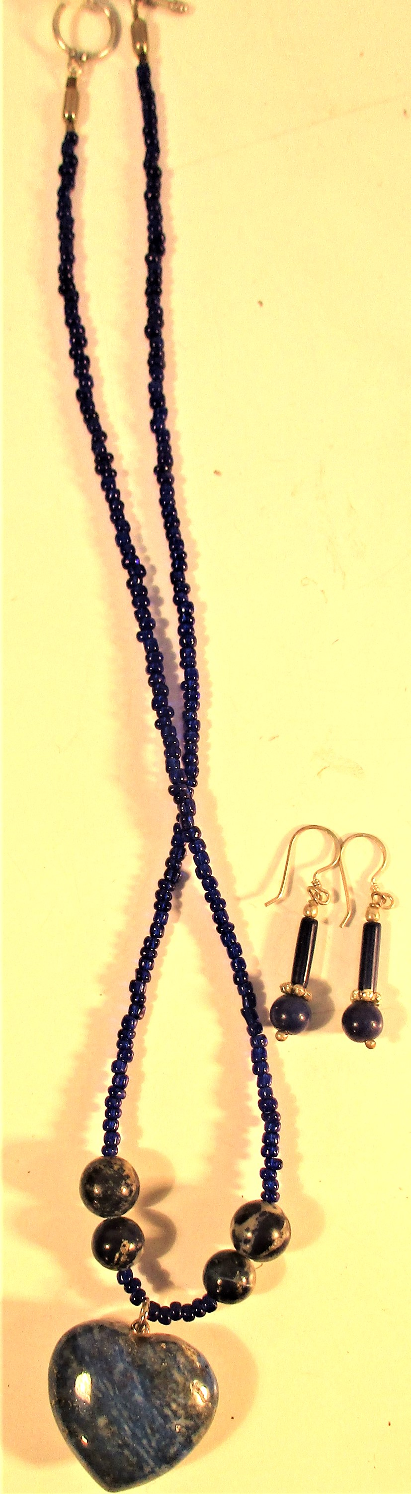 Lapis lazuli necklace with heart shaped pendant, black beads and pair of lapis stone earrings
