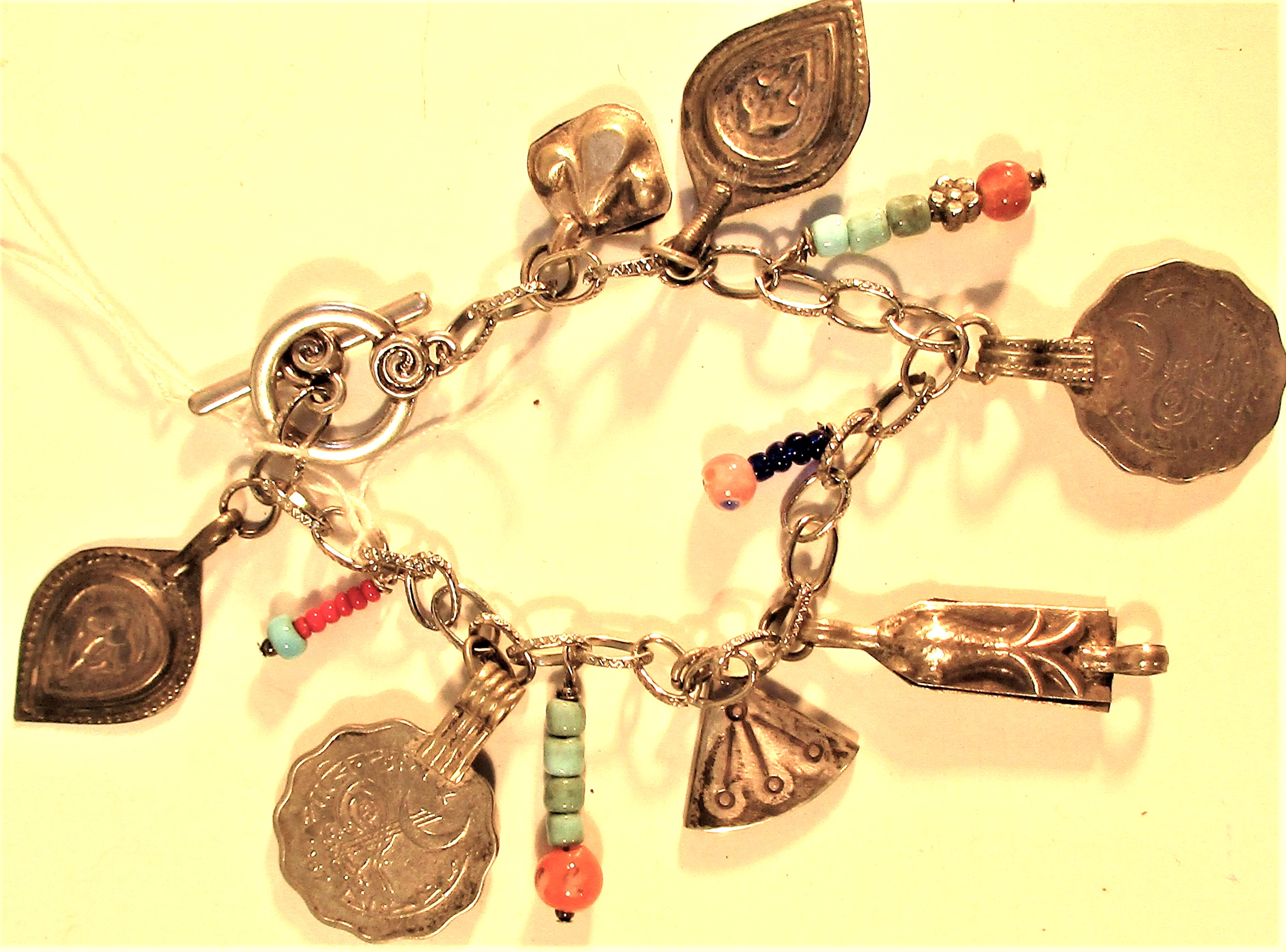 Antique bracelet of old Afghan coins, semi precious and glass beads.
