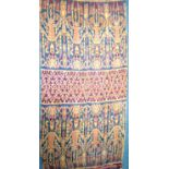 Hinggi from Sumba. A warp-ikat cotton textile. Using vegetable dyes, there are four figures at