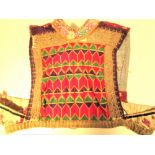 Turkoman dress front. This is typical Turkoman embroidery and patterning. It would have been applied