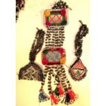 Afghanistan. Mirror, cloves and 2 beaded amulets. This would be hung amongst cloths, textiles and