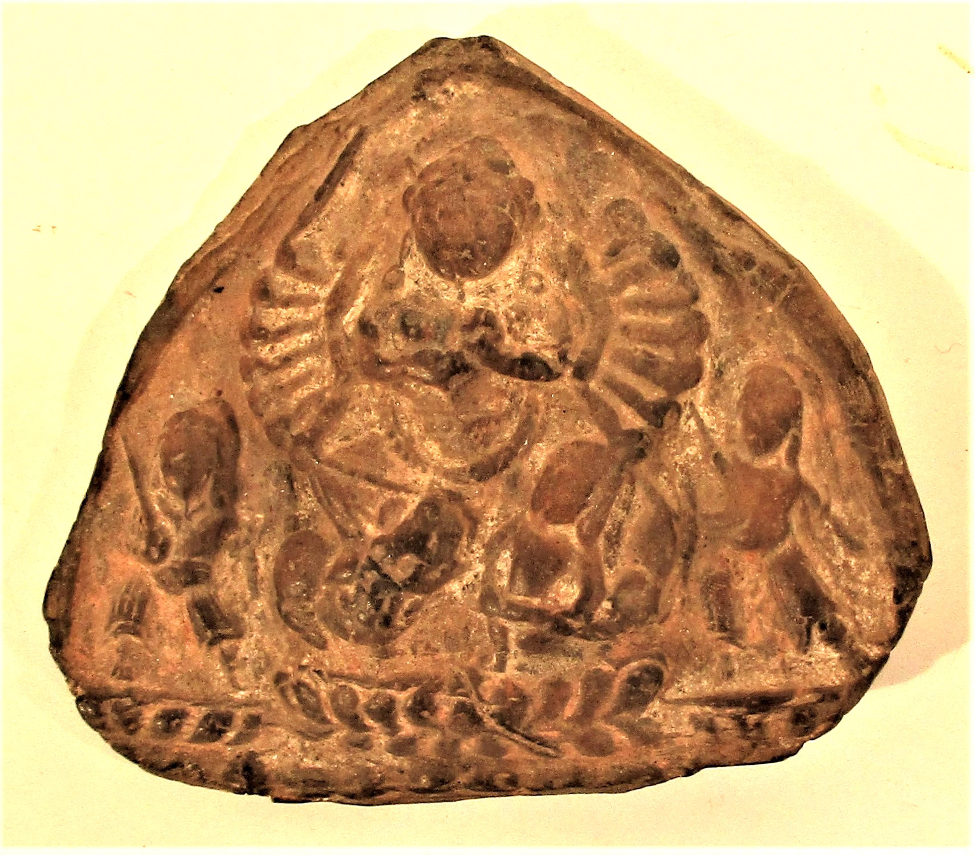 Clay plaque of Garuda. 10 x 10cm.