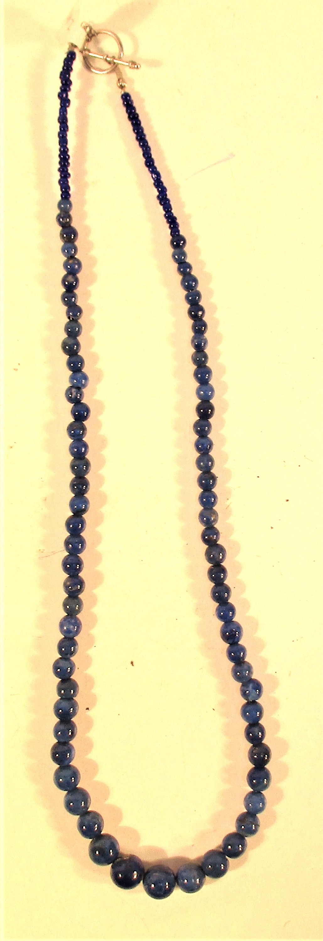 Necklace of graded lapis lazuli beads. Lapis lazuli is mined in a very remote corner of Afghanistan.