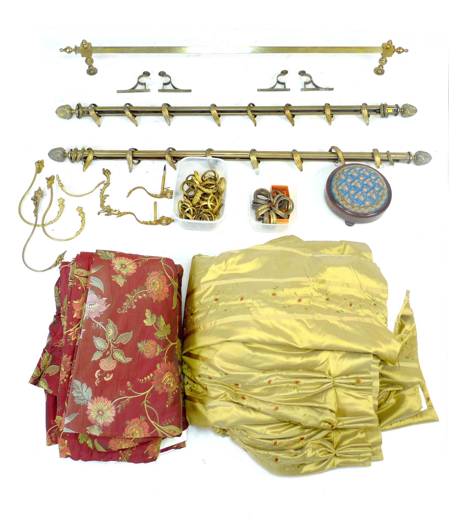 A group of brass curtain rails and curtains, including a pair of rails with pineapple finials and