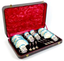 An Edwardian Royal Worcester porcelain and silver mounted coffee set, dated 1904, with scalloped