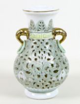 A modern Chinese porcelain reticulated vase, of baluster form with gilt highlighted elephant head