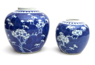 Two Chinese blue and white ceramic ginger jars, each decorated in underglaze blue with cherry