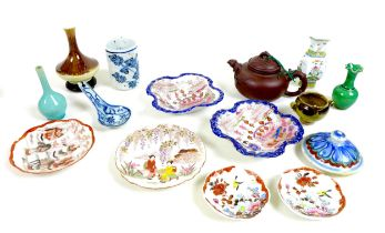 A collection of miniature Chinese pottery and porcelain items, including a Yixing pottery teapot and