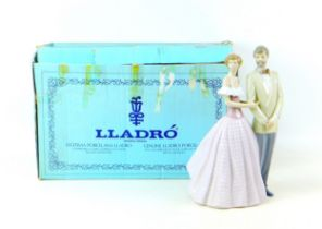 A Lladro figural group 'An evening Out', with impressed and number '53540' to its base, 17.5 by 20