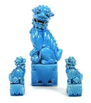 A modern Chinese turquoise glazed figure of a Buddhistic lion dog, modelled seated with left forepaw