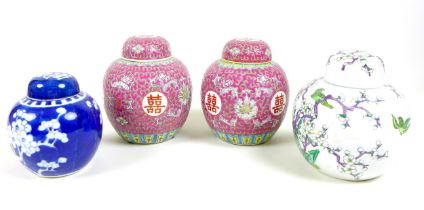 A group of four Chinese porcelain ginger jars and covers, comprising a pair decorated in pink