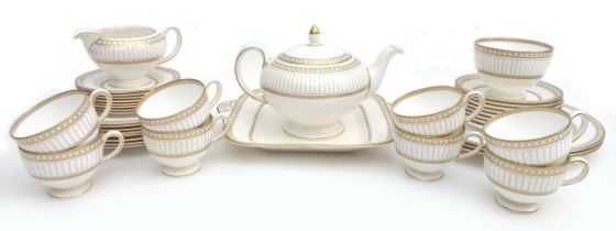A Wedgwood part tea service, decorated in the 'Colonnade' pattern, W4339, comprising of eight cups