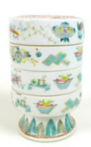 A Chinese porcelain stacking box, late 19th century, of four sections with a circular foot,