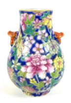 A small Chinese porcelain 'Hu' shaped vase, likely Republic period, decorated with a millefleurs