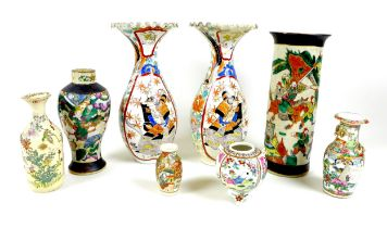 A group of Chinese and Japanese vases, comprising a Chinese sleeve vase, early 20th century,