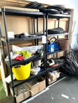 A pair of black plastic shelving units, with contents, including a quantity of child's bike tyres, a