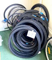 A larger group of bicycle tyres and wheels, including Tiger and Schwalbe.