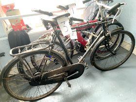 A vintage Triumph black painted gent's road bike.