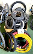 A group of BMX and children's bicycle tyres, including a pair of red and a pair of yellow Duro