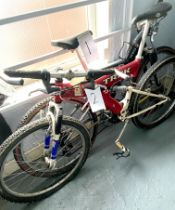 A Trek red painted gent's mountain bike, with dual suspension.